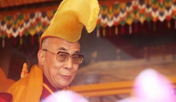 <em>The Dalia Lama presents his teachings at the Kalachakra in Bodh Gaya, India. Photo: Jim Luce.</em>