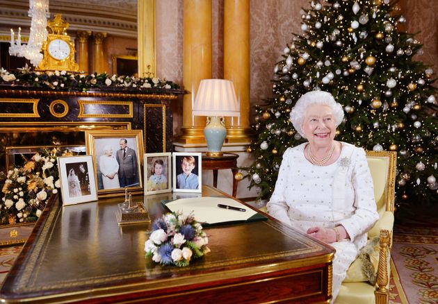 Queen Elizabeth II at a desk in the 1844 Room at Buckingham Palace, London, after recording her Christmas...
