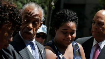 Eric Garner's daughter, Erica Garner (R), attends a news conference with Rev. Al Sharpton and other family members after meeting with the U.S. Department of Justice in the Brooklyn borough of New York City, U.S., June 21, 2017. REUTERS/Brendan McDermid