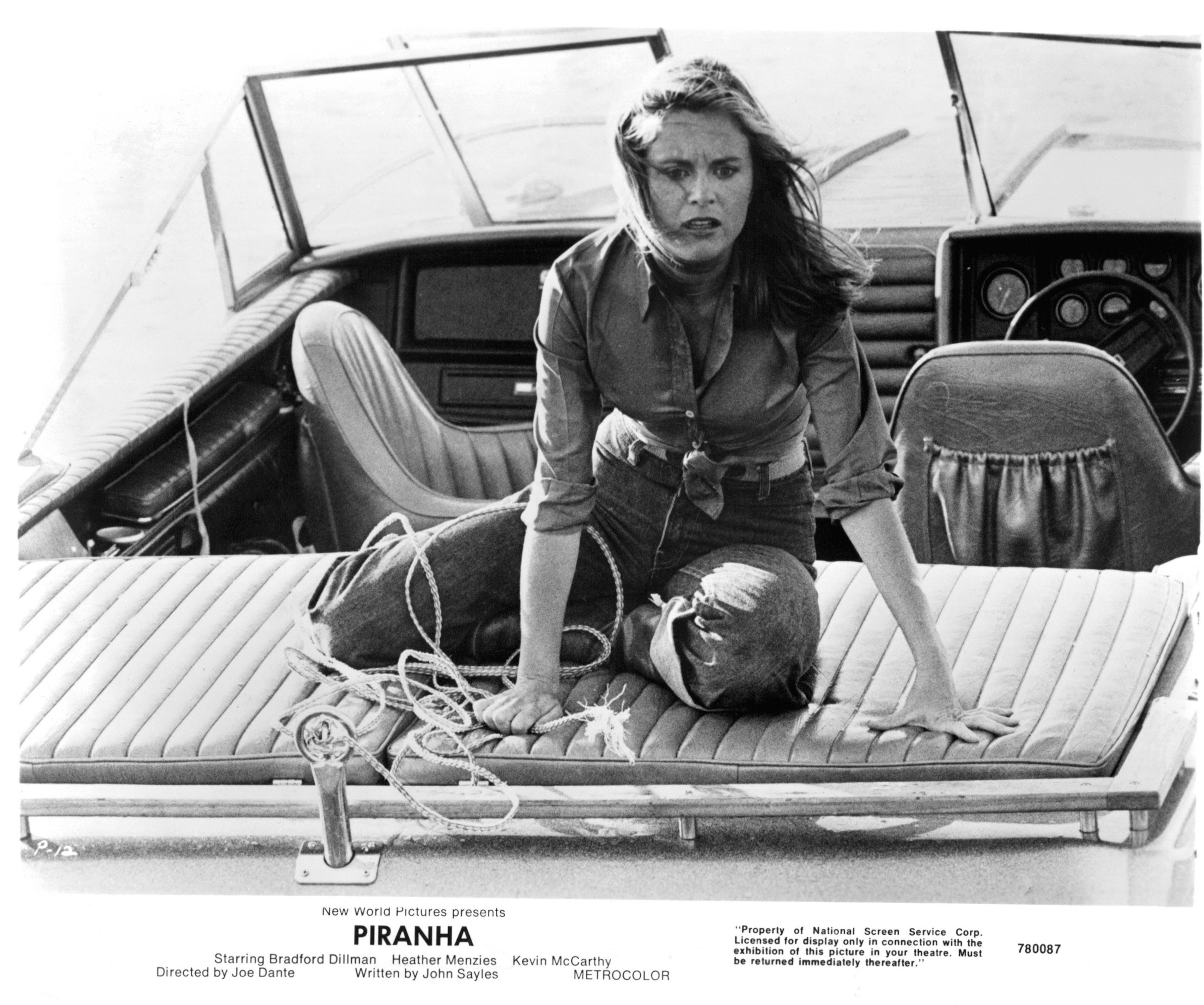 Heather Menzies-Urich sits on the back of a boat in a scene from the film 'Piranha', 1978. (Photo by United Artists/Getty Images)