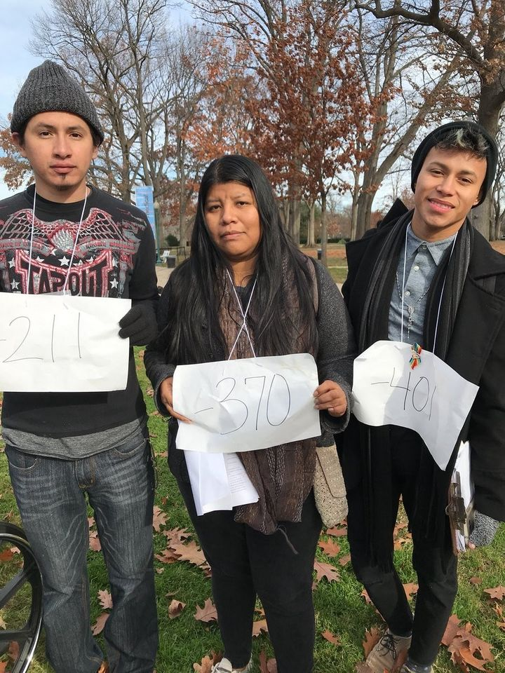 <strong>Dreamers hold up signs showing how many days they have left in the U.S. before their DACA expires.</strong>