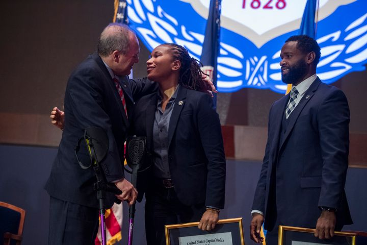 House Majority Whip Steve Scalise hugs Capitol Police Special Agent Crystal Griner as fellow Special Agency David Bailey look