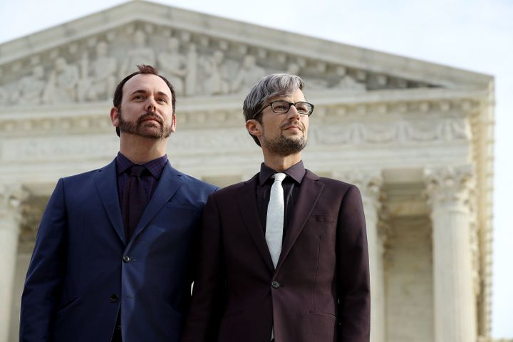 David Mullins (left) and Charlie Craig, the gay couple at the center of a case before the Supreme Court involving a baker who