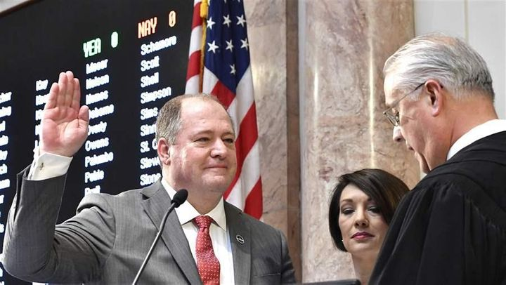 Republican Kentucky state Rep. Jeff Hoover, left, is sworn in as House speaker. Hoover resigned his post as speaker this mont