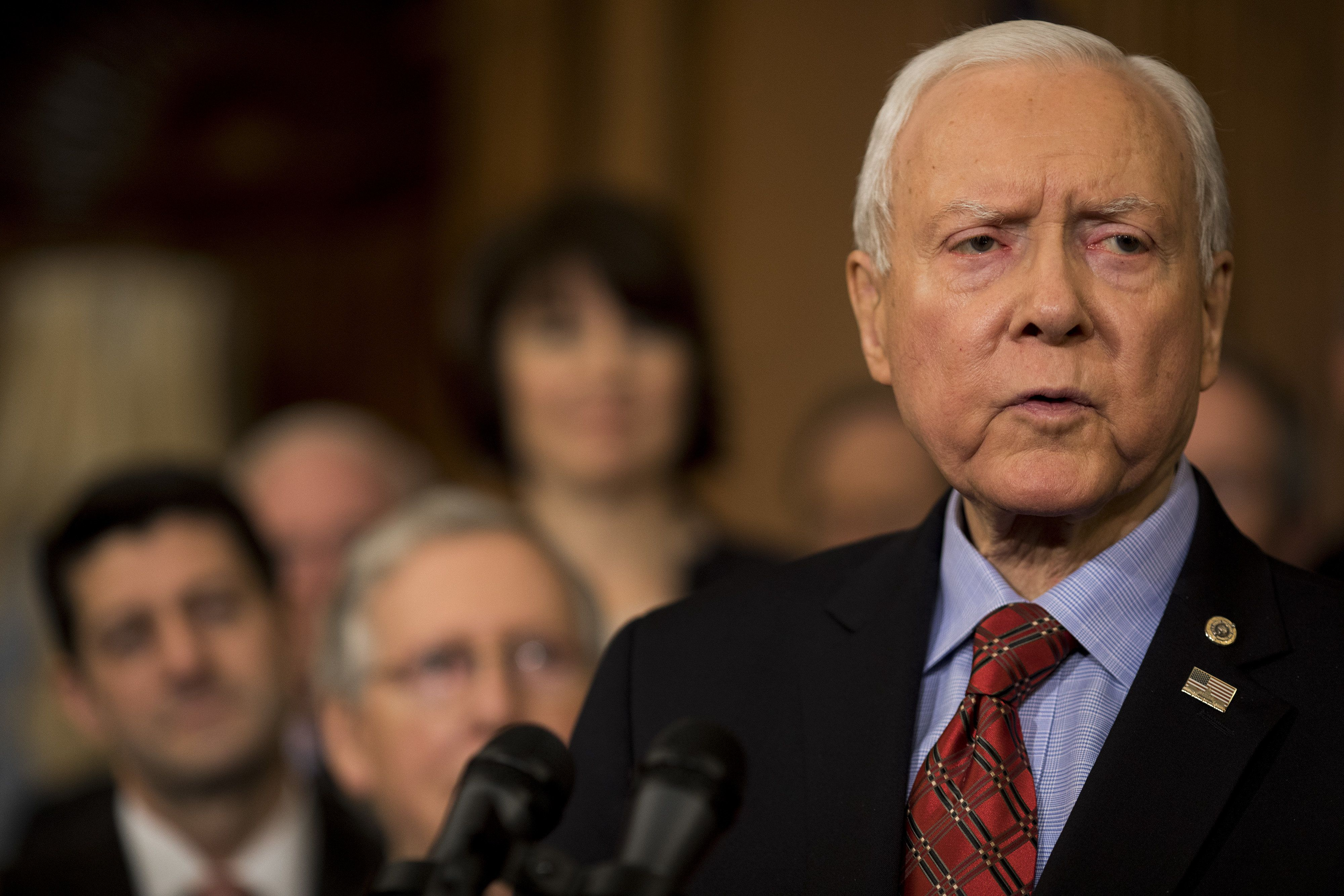 Senator Orrin Hatch, a Republican from Utah, speaks during a Tax Cuts and Jobs Act enrollment ceremony at the U.S. Capitol in Washington, D.C., U.S., on Thursday, Dec. 21, 2017. Republicans want to channel momentum from the GOP's victory on taxes into a push to overhaul the nation's welfare programs, though some of President Donald Trump's advisers prefer a less controversial infrastructure plan at the top of his agenda. Photographer: Aaron P. Bernstein/Bloomberg via Getty Images