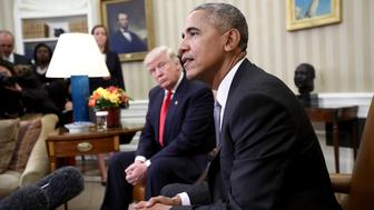 WASHINGTON, DC - NOVEMBER 10:  President-elect Donald Trump (L) listens as U.S. President Barack Obama speaks during a meeting in the Oval Office November 10, 2016 in Washington, DC. Trump is scheduled to meet with members of the Republican leadership in Congress later today on Capitol Hill.  (Photo by Win McNamee/Getty Images)
