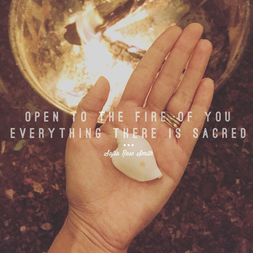 """Sofia's hand hovers over an open fire. Inside her palm is a white shell. Text reads: """"open to the fire of you / everythi"""