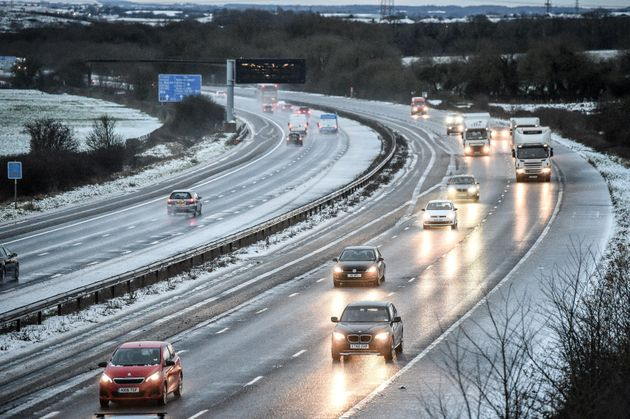 Snow, ice and strong winds hit large parts of UK