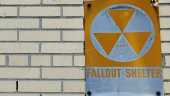 A yellow nuclear fallout shelter sign is seen hung on a building in the Brooklyn borough of New York, U.S., December 7, 2017. Picture taken December 7, 2017.  REUTERS/Brendan McDermid