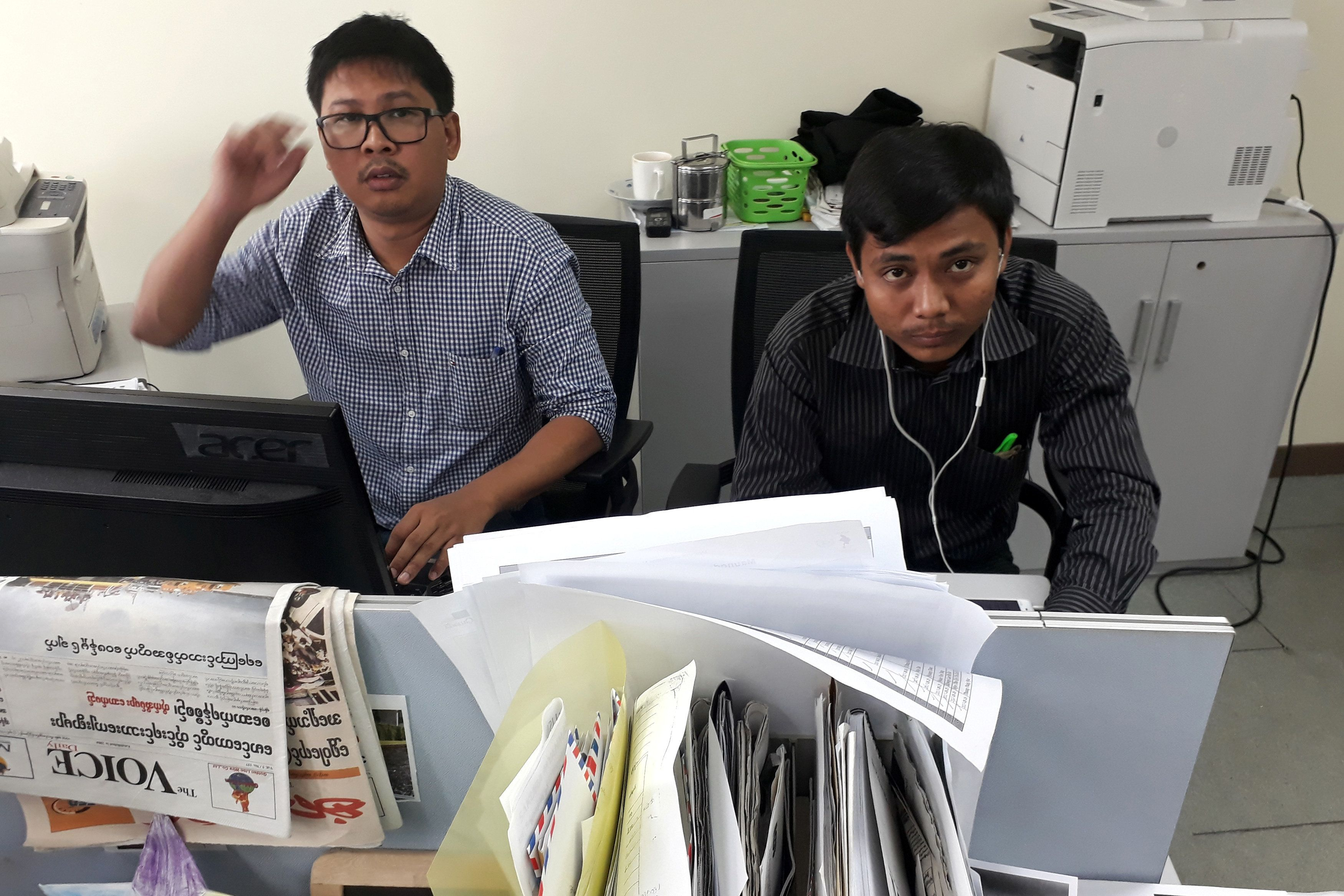 Reuters journalists Wa Lone (L) and Kyaw Soe Oo, who are based in Myanmar, pose for a picture at the Reuters office in Yangon