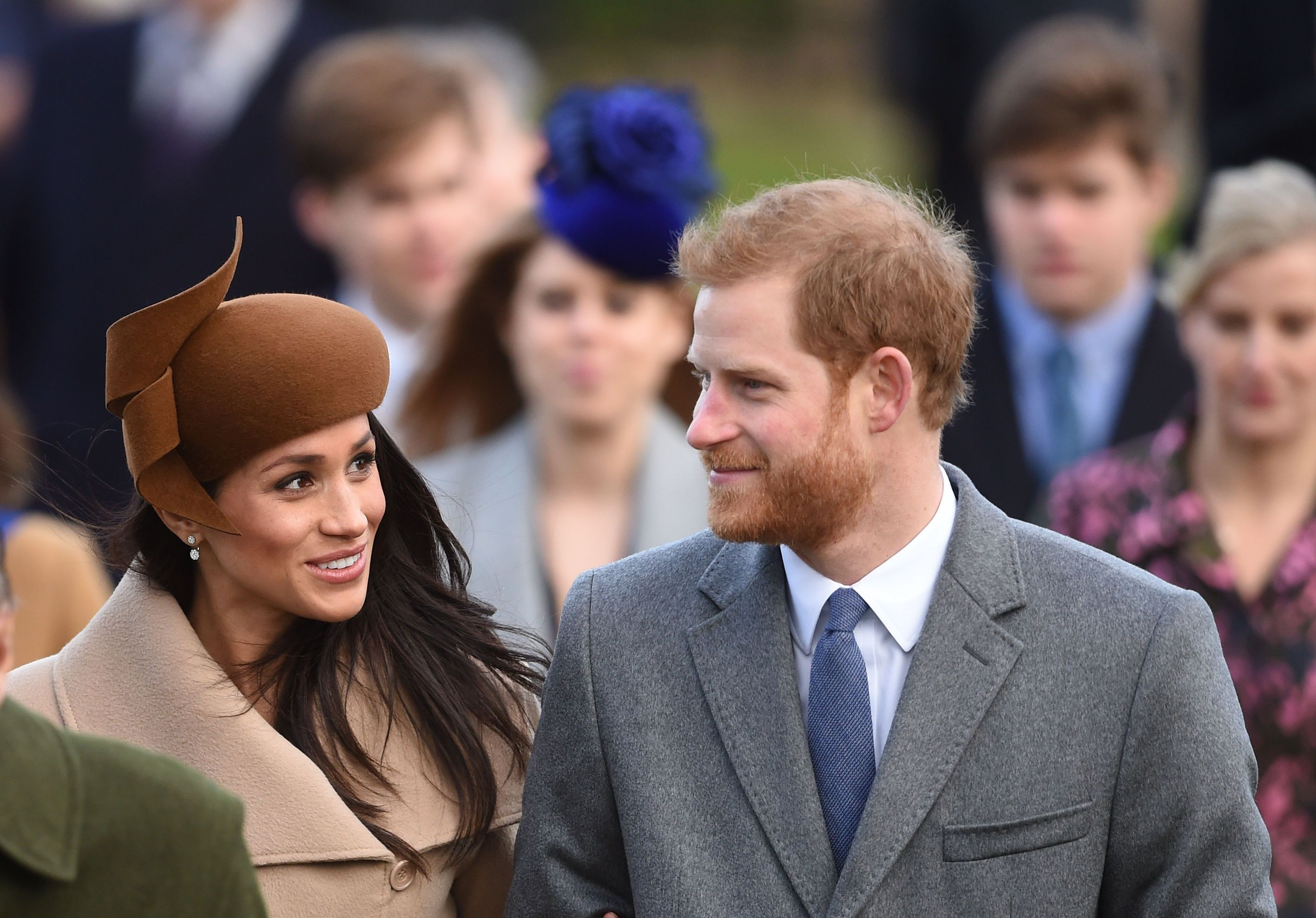 Prince Harry and Meghan Markle arrive to attend Christmas morning church service at St Mary Magdalene Church in Sandringham,