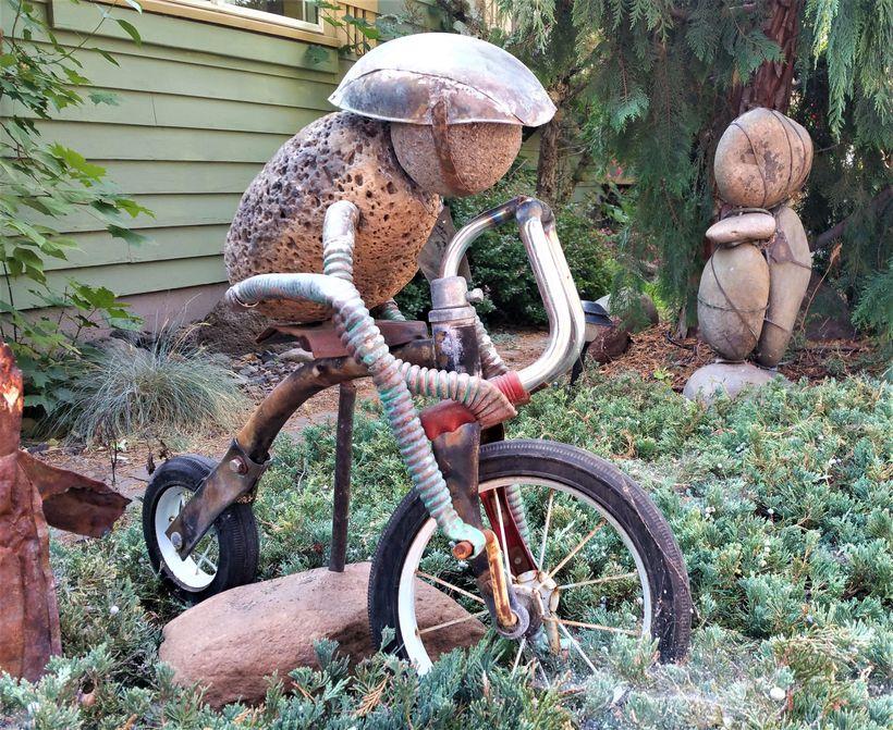 <em>Gifford</em>'s p<em>int-size tricyclist on Riverfront Street in Bend, Oregon</em>