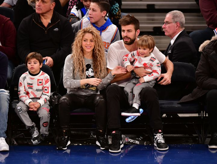 Shakira and boyfriend Gerard Piqué took in the New York Knicks home basketball game with their two sons Christmas Day.