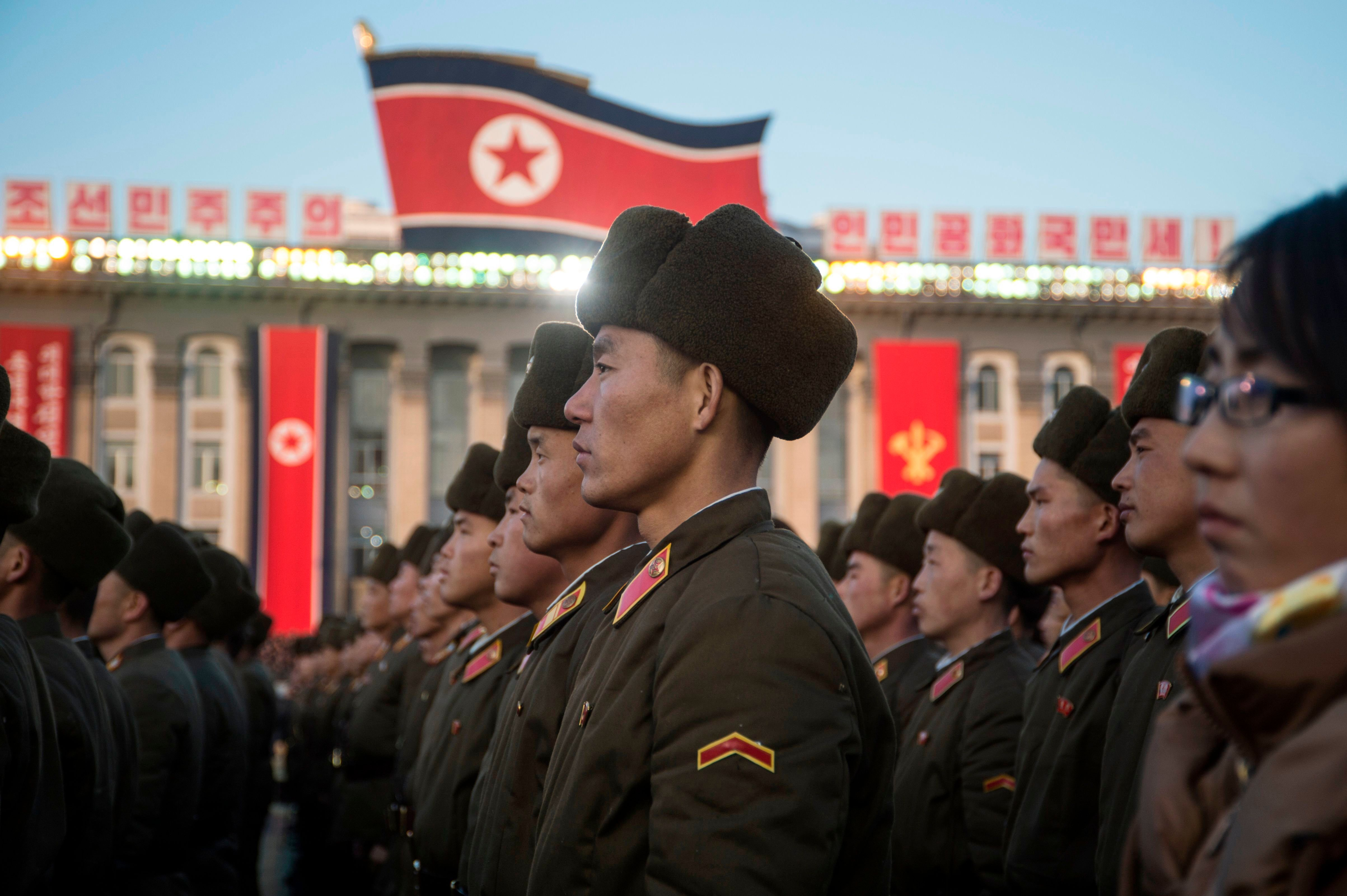 North Korean soldiers attend a mass rally in Pyongyang to celebrate North Korea's declaration on Nov.29...