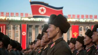 TOPSHOT - North Korean soldiers attend a mass rally to celebrate the North's declaration on November 29 it had achieved full nuclear statehood, on Kim Il-Sung Square in Pyongyang on December 1, 2017. North Korea's leader Kim Jong-Un declared the country had achieved a 'historic cause' of becoming a nuclear state, its state media said on November 29, after the country tested an intercontinental ballistic missile earlier in the day. / AFP PHOTO / Kim Won-Jin        (Photo credit should read KIM WON-JIN/AFP/Getty Images)