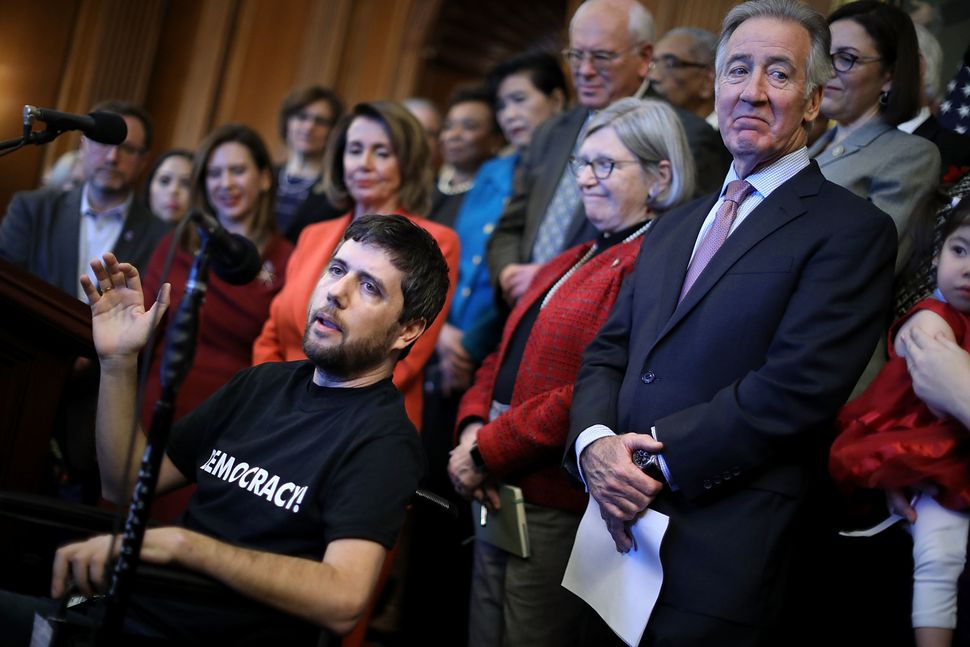 Ady Barkan speaks at a Dec. 19, 2017, press conference against the GOP tax bill organized by congressional Democratic leaders