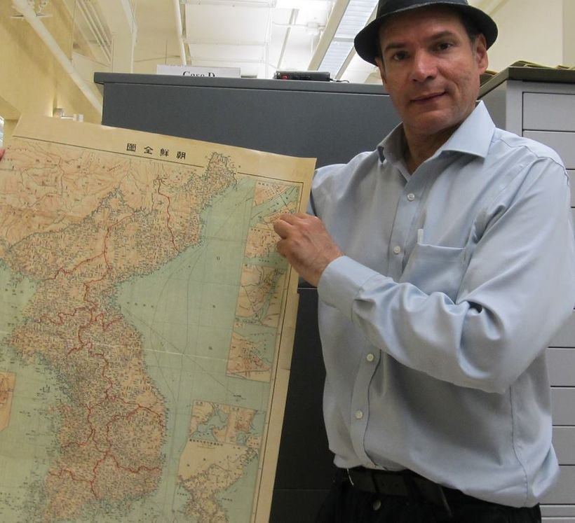 The author of this piece with a map of the peninsula.