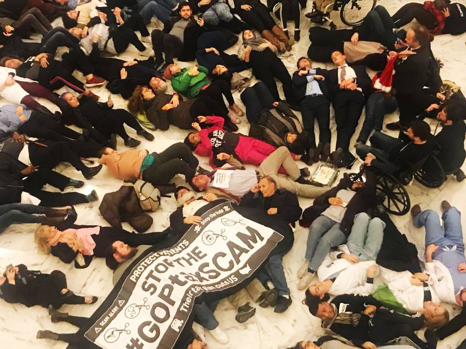 Ady Barkan and dozens of other protesters participate in a die-in against the GOP tax bill in the Russell Senate Office Build