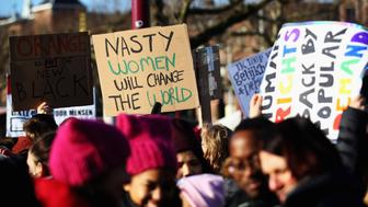AMSTERDAM, NETHERLANDS - JANUARY 21:  Demonstrators with a sign saying 'Nasty Women will Change the World ' make their way from the iamsterdam statue in front of the Rijksmuseum towards US Consulate during the Women's March held at Museumplein on January 21, 2017 in Amsterdam, Netherlands.  The Women's March originated in Washington DC but soon spread to be a global march calling on all concerned citizens to stand up for equality, diversity and inclusion and for women's rights to be recognised around the world as human rights. Global marches are now being held, on the same day, across seven continents.  (Photo by Dean Mouhtaropoulos/Getty Images)