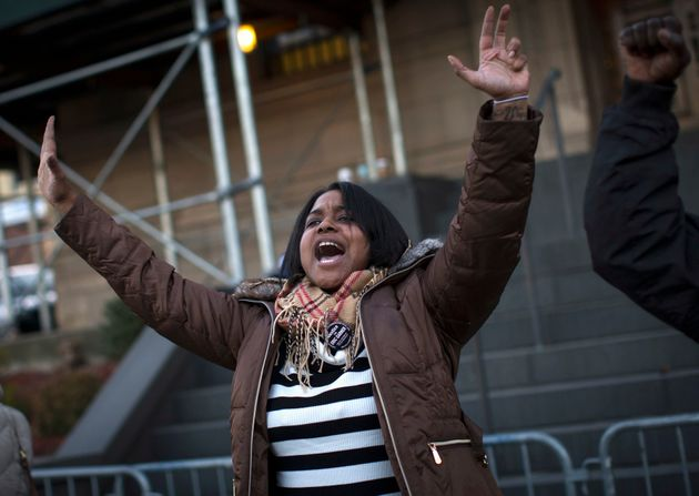 Erica Garner, the daughter of Eric Garner, leads a chant at a protest and candlelight vigil in the Staten...
