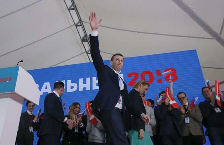 Russian opposition leader Alexei Navalny and his wife, Yulia, attend a rally in Moscow calling for the upholding of his