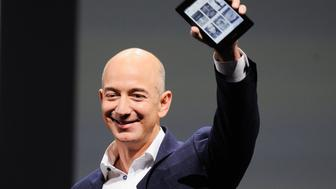 Amazon CEO Jeff Bezos holds up a Kindle Paperwhite during Amazon's Kindle Fire event in Santa Monica, California September 6, 2012.  REUTERS/Gus Ruelas  (UNITED STATES - Tags: SCIENCE TECHNOLOGY BUSINESS)