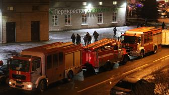 SAINT-PETERSBURG, RUSSIA - DECEMBER 27 : Security forces are seen outside the supermarket in Kalinina Square after an explosion in St. Petersburg, Russia on December 27, 2017. A total of nine people were injured after an explosion hit a store in St. Petersburg, Russia. (Photo by Sergey Mihailicenko/Anadolu Agency/Getty Images)