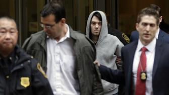 Martin Shkreli, chief executive officer of Turing Pharmaceuticals LLC, center, and attorney Evan Greebel, left, exit federal court in New York, U.S., on Thursday, Dec. 17, 2015. Shkreli was arrested on alleged securities fraud related to Retrophin Inc., a biotech firm he founded in 2011. Greebel is accused of conspiring with Shkreli in part of the scheme. Photographer: Peter Foley/Bloomberg via Getty Images