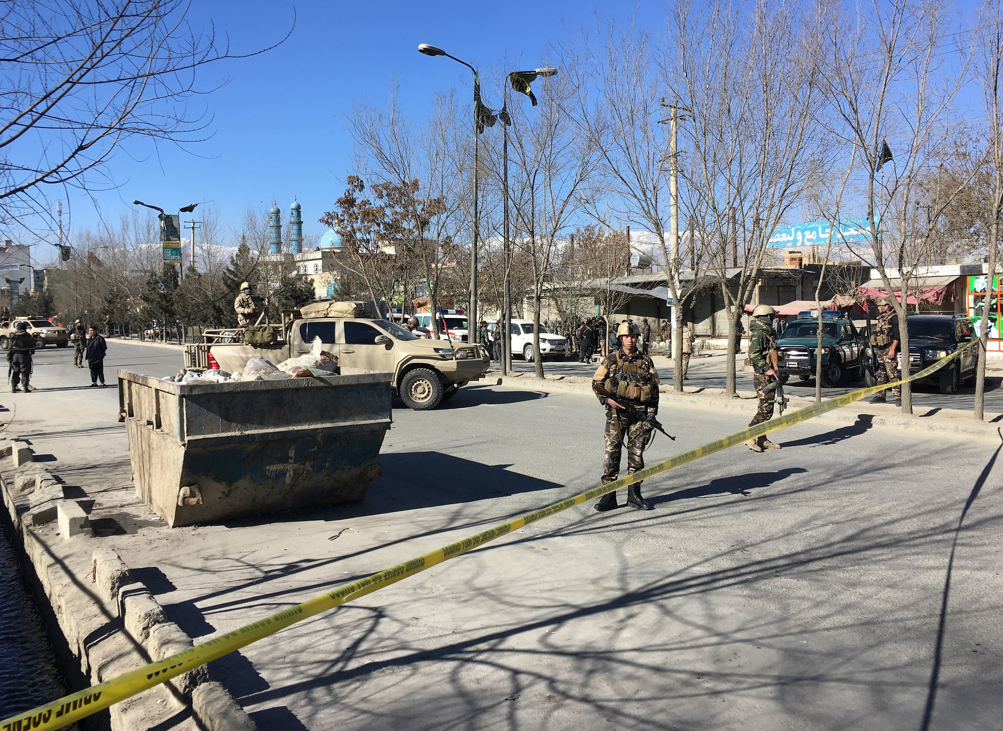 Afghan security forces stand guard near the site of multiple blasts in Kabul on December 28, 2017. At least five people were killed and many others were wounded in multiple blasts near a media outlet and mosque in Kabul on December 28, officials said, in the latest violence to hit the Afghan capital. / AFP PHOTO / Shah MARAI        (Photo credit should read SHAH MARAI/AFP/Getty Images)