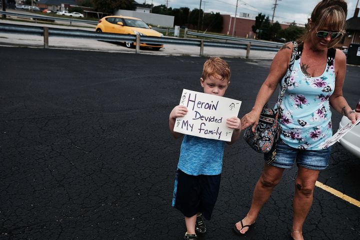 A boy attends a march through the streets of Norwalk agains the epidemic of heroin.