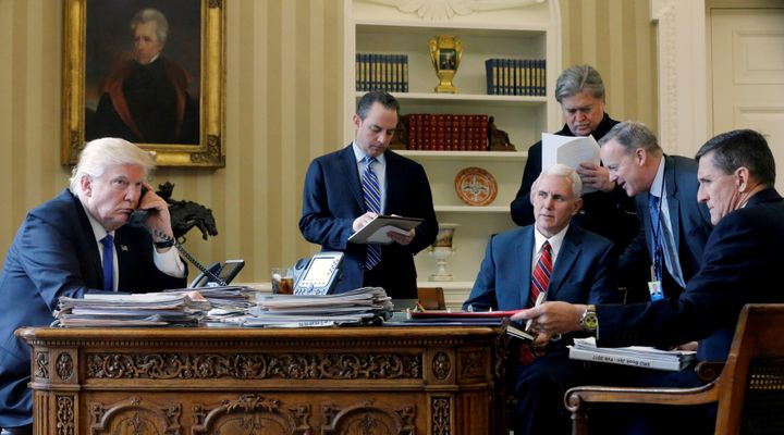 President Donald Trump is joined by Chief of Staff Reince Priebus, center, Vice President Mike Pence, senior adviser Steve Ba