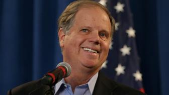 Democrat Doug Jones, who won the special U.S. Senate election against Republican candidate Roy Moore, speaks during a news conference in Birmingham, Alabama, U.S., December 13, 2017.  REUTERS/Marvin Gentry