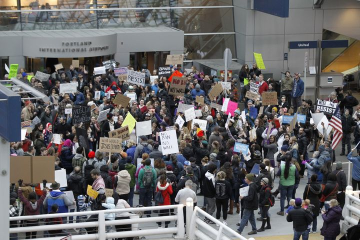 Activists gather at Portland International Airport in Oregon to protest Trump's initial travel ban on Jan. 29.