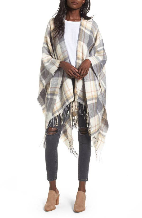 """Plus, it can double as a scarf on super cold days. Get it <a href=""""https://shop.nordstrom.com/s/bp-plaid-cape/4629487"""" target"""