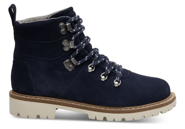 """Get them <a href=""""http://www.toms.com/women/waterproof-navy-suede-womens-summit-boots"""" target=""""_blank"""">here</a>."""
