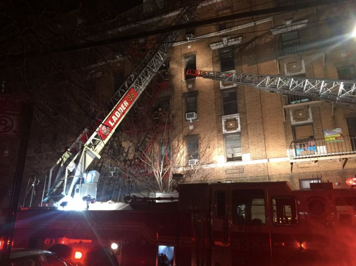 Firefighters responded to a massive blaze at a Bronx apartment building in which at least 12 people had died late Thursday.