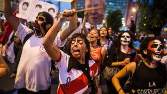 Demonstrators march during a protest against the pardon of former Peruvian President Alberto Fujimori in Lima, on December 28, 2017.  Peruvian President Pedro Pablo Kuczynski granted a humanitarian pardon Sunday to ex-president Alberto Fujimori, who has been hospitalized since Saturday and is serving a 25-year sentence for crimes against humanity. / AFP PHOTO / ERNESTO BENAVIDES        (Photo credit should read ERNESTO BENAVIDES/AFP/Getty Images)