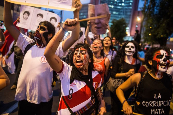 Demonstrators march in Lima on Thursday during a protest against the pardon of former Peruvian President Alberto Fujimori.