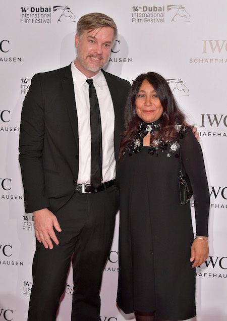 Brad Niemann and Haifaa al Mansour pose on the red carpet for the IWC Filmmaker Award