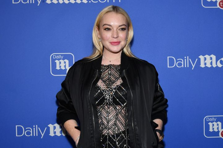 Lindsay Lohan attends the DailyMail.com holiday party with Flo Rida on Dec. 6, 2017.