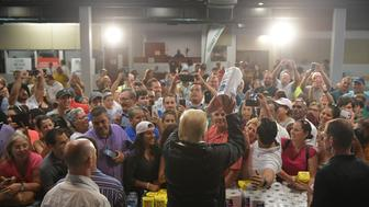 US President Donald Trump throws a paper towel roll as he visits the Cavalry Chapel in Guaynabo, Puerto Rico on October 3, 2017. Nearly two weeks after Hurricane Maria thrashed through the US territory, much of the islands remains short of food and without access to power or drinking water. / AFP PHOTO / MANDEL NGAN        (Photo credit should read MANDEL NGAN/AFP/Getty Images)