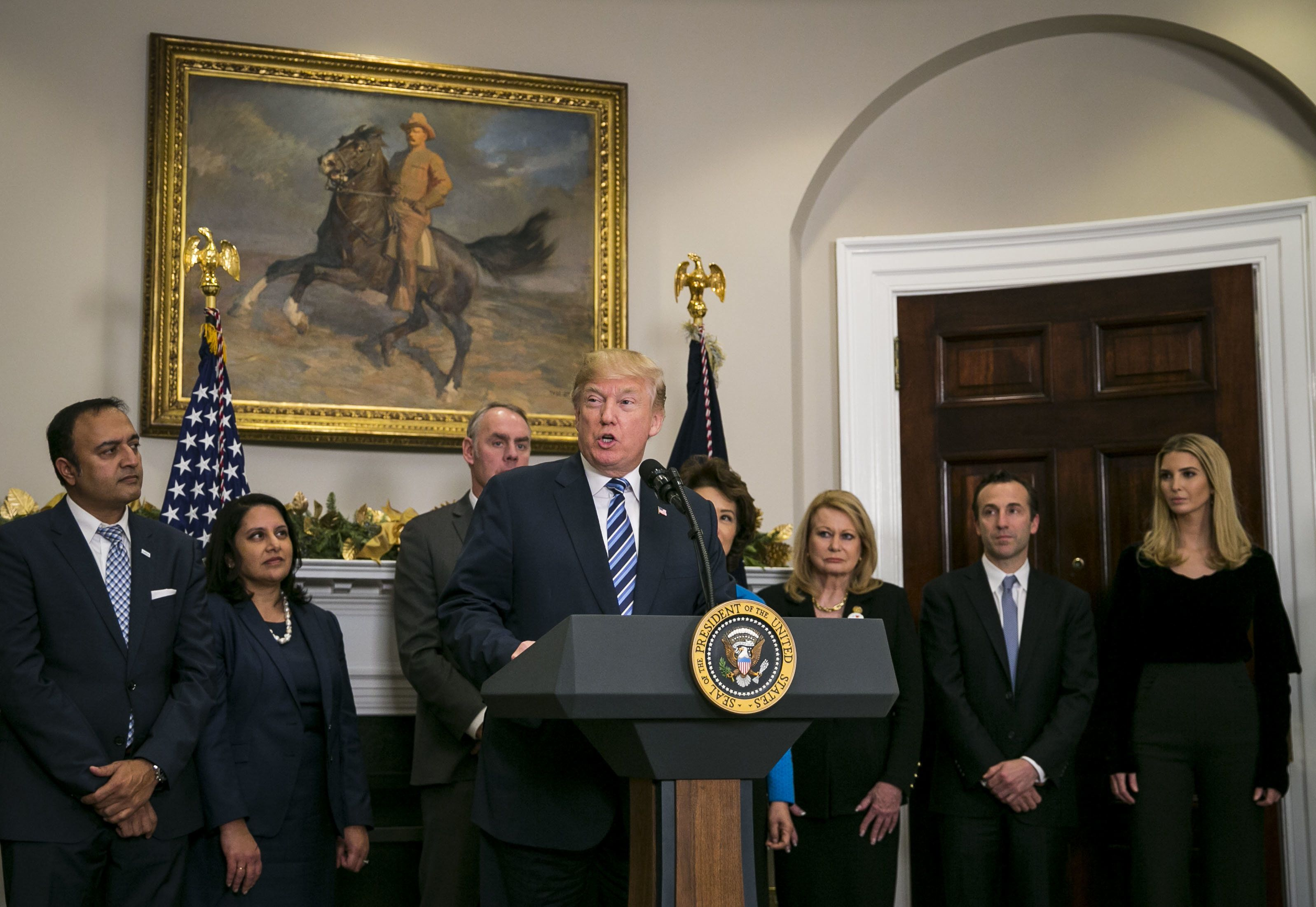 U.S. President Donald Trump speaks during an event in the Roosevelt Room of the White House, Thursday, Dec. 14, 2017. Trump trumpeted his effort to slash government rules as 'the most far-reaching regulatory reform in history.' Photographer: Al Drago/Bloomberg via Getty Images