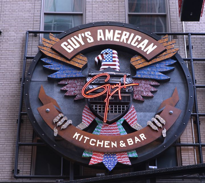 The exterior marquee for Guy's American Kitchen and Bar in Times Square, New York City.