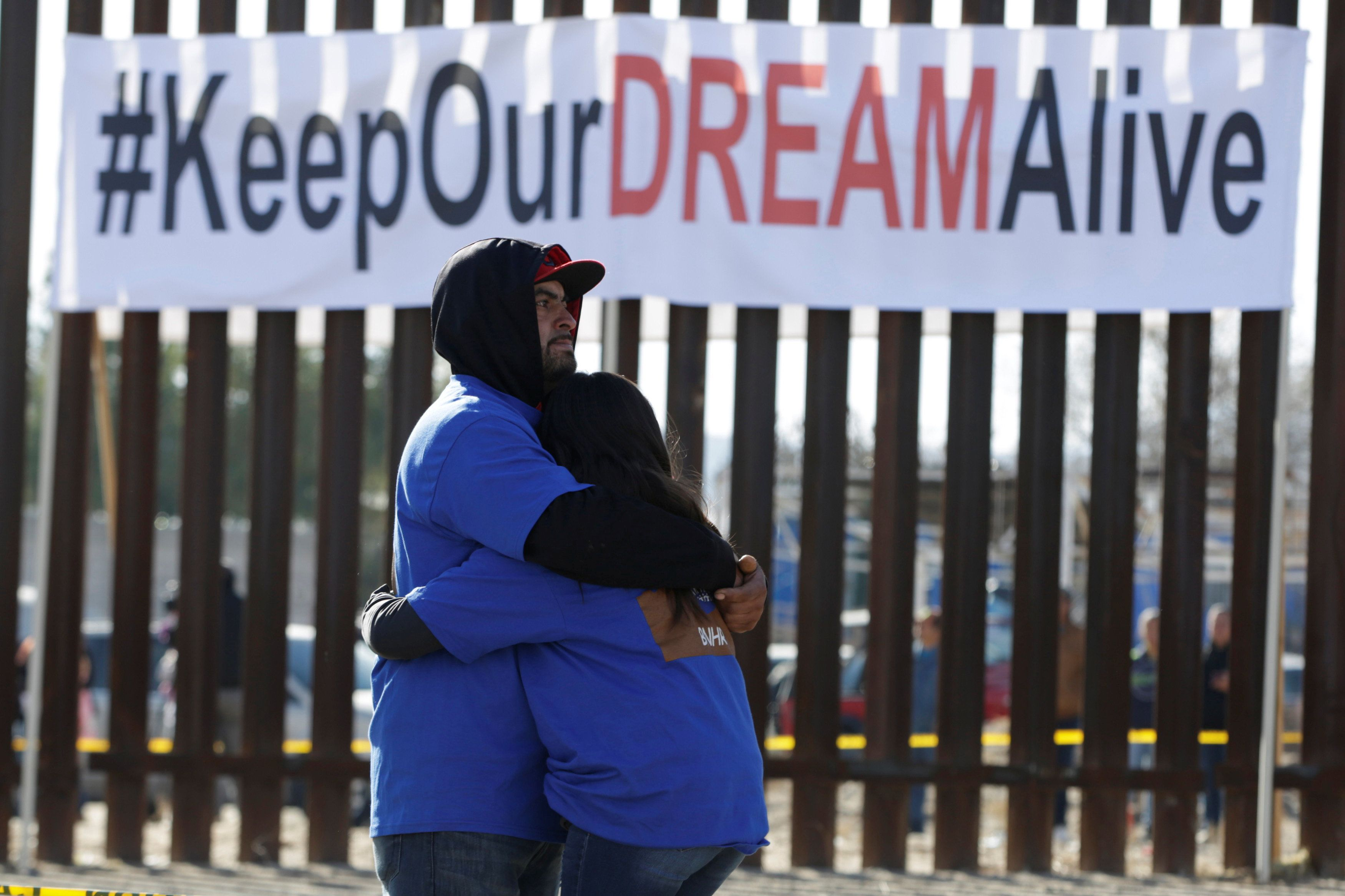 """Dreamers"" hug as they meet with relatives during the ""Keep Our Dream Alive"" binational meeting at a new section of the borde"