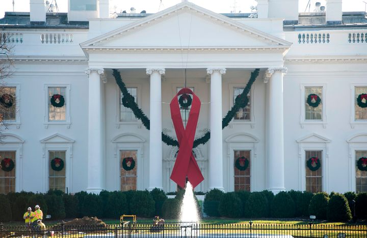 A red ribbon in recognition of World AIDS Day hangs from the North Portico of the White House in Washington, D.C.