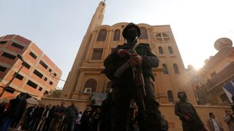 Security forces stand guard at the site of attack on a church in the Helwan district south of Cairo, Egypt December 29, 2017. REUTERS/Amr Abdallah Dalsh