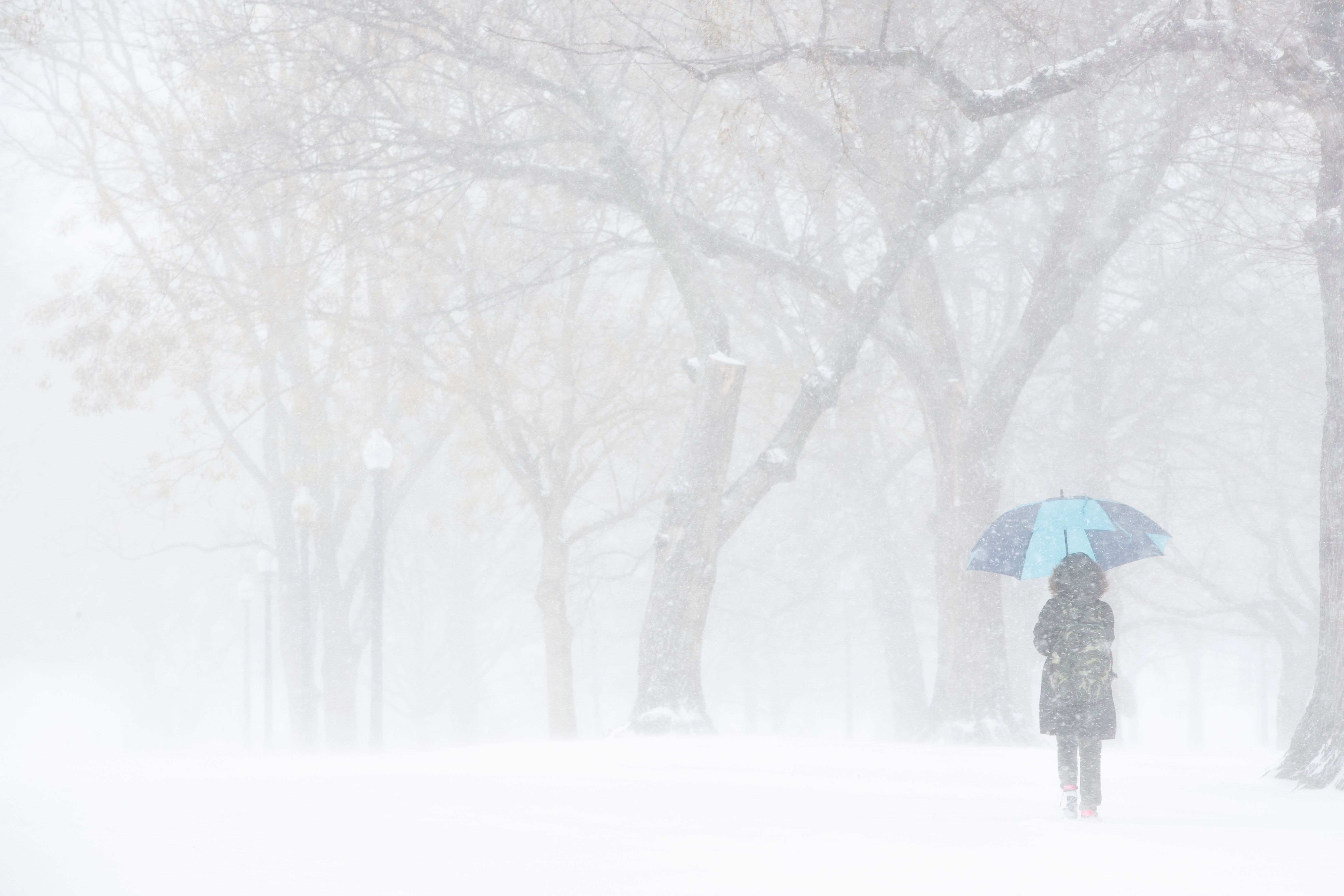 BOSTON, MA - DECEMBER 25: A Christmas Day snowstorm creates whiteout conditions at the Boston Common on Dec. 25, 2017. (Photo by Dina Rudick/The Boston Globe via Getty Images)