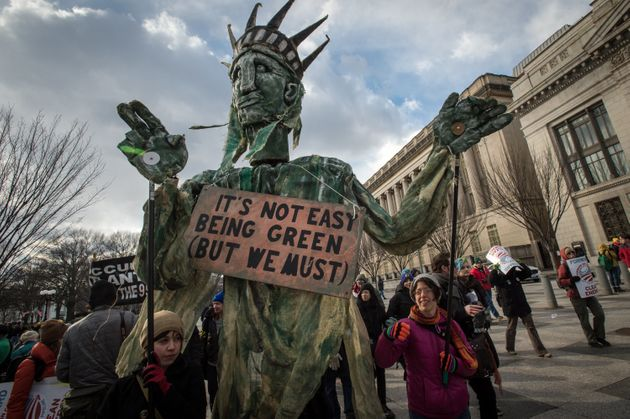 People march to the White House in protest against the Keystone XL Tar Sands Pipe Line in February
