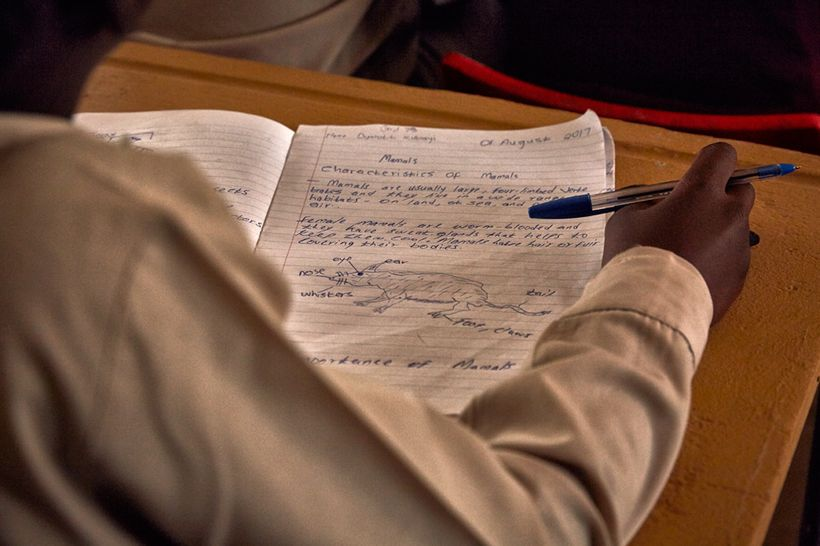 A student's notebook during a class about mammals, Mhala Mhala Primary School, South Africa, 2017.