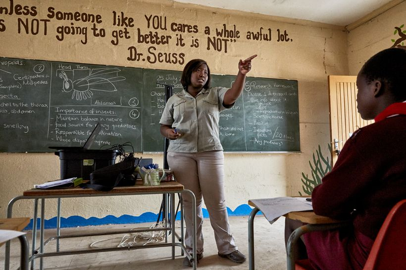 Bush Babies education officer Lewyn Maefala stands in front of the class, Mhala Mhala Primary School, South Africa, 2017.